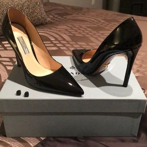Prada pointed toe, patent leather pumps.